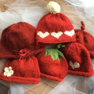 "92 Red Hats were knit for the American Heart Association's campaign ""Little Hats, Big Hearts."""